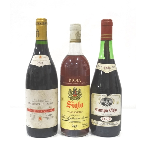 697 - SELECTION OF THREE BOTTLES OF RIOJA comprising: one Campo Viejo Rioja 1979 Vintage (70cl) approx. 5c...