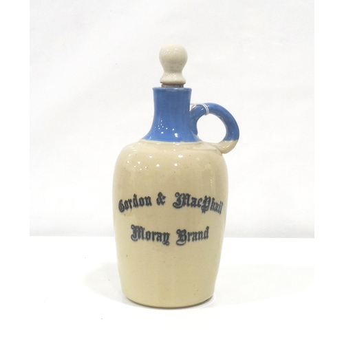 700 - GORDON & MACPHAIL MORAY BRAND DECANTER An empty earthenware decanter from 1970's in Blue and Cream w...
