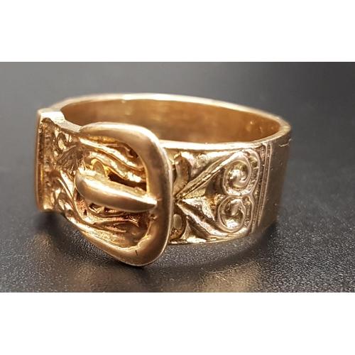 6 - GEORGE V NINE CARAT GOLD BUCKLE DESIGN RING with scroll decoration, hallmarks London 1977, ring size...