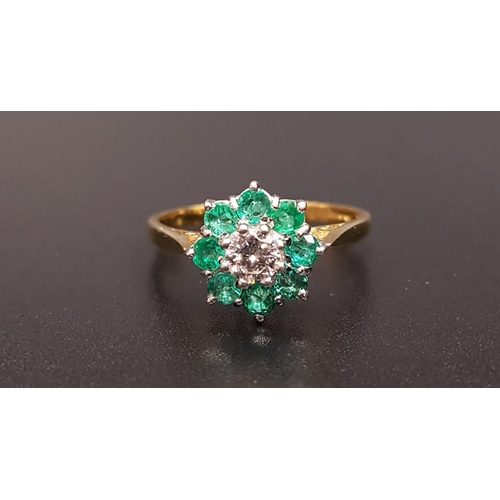 9 - EMERALD AND DIAMOND CLUSTER RING the central round brilliant cut diamond approximately 0.25cts in ei...