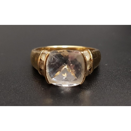 12 - QUARTZ DRESS RING the central cushion ckeckerboard faceted gemstone flanked by three round cut quart...