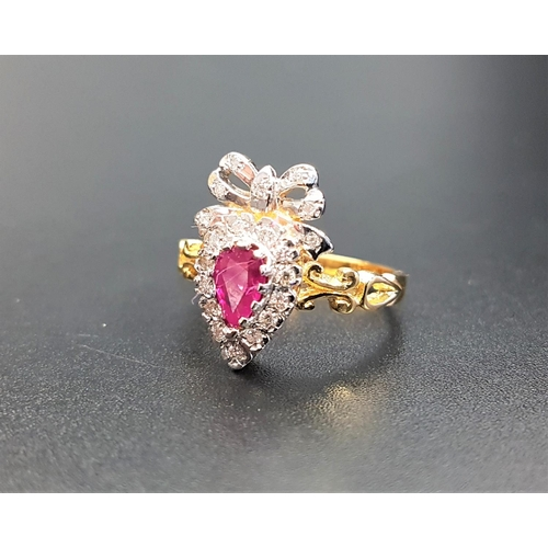 17 - UNUSUAL RUBY AND DIAMOND CLUSTER RING the pear cut ruby in diamond surround and surmounted by a diam...