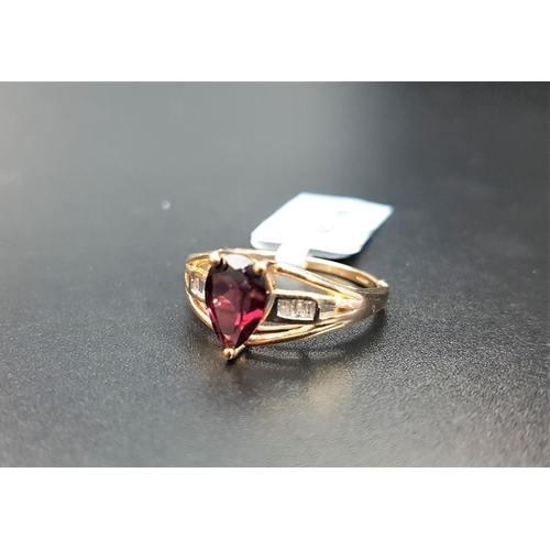 21 - CERTIFIED GARNET AND DIAMOND RING the central pear cut Rajasthan garnet weighing 1.62cts, flanked by...