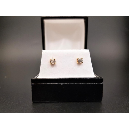 23 - PAIR OF DIAMOND STUD EARRINGS the round brilliant cut diamonds totaling approximately 0.3cts, in eig...