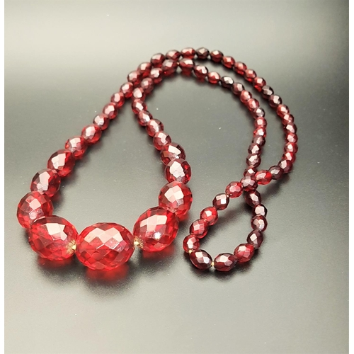 25 - VINTAGE FACETED GRADUATED AMBER BEAD NECKLACE with screw clasp, approximately 80cm long...