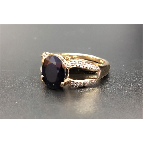 27 - SAPPHIRE AND DIAMOND DRESS RING the central dark oval cut sapphire approximately 2.75cts, flanked by...