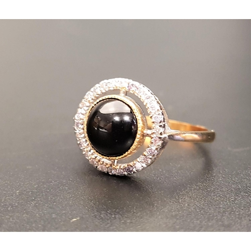 29 - ATTRACTIVE ONYX AND DIAMOND DRESS RING the central round cabochon onyx in multi diamond surround wit...