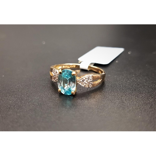 31 - CERTIFIED BLUE AND WHITE ZIRCON RING the central oval cut Ratanakiri blue zircon weighing 1.97cts, f...