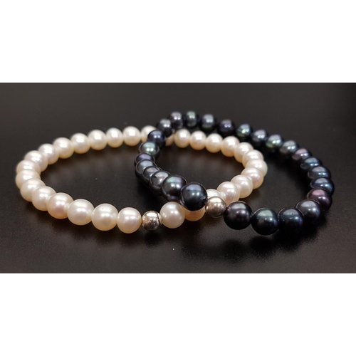 33 - PAIR OF FRESHWATER PEARL BRACELETS one with black pearls and the other white pearls, both on elastic...