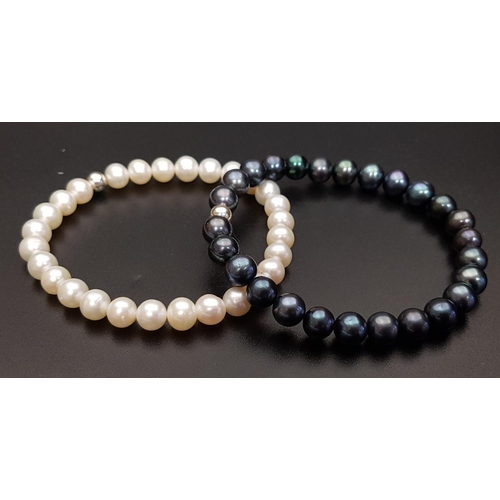 34 - PAIR OF FRESHWATER PEARL BRACELETS one with black pearls and the other white pearls, both on elastic...