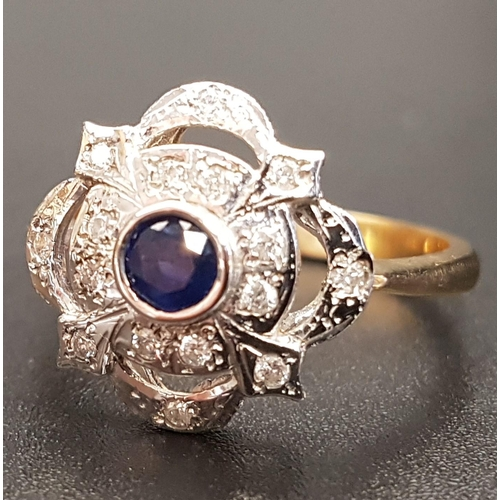 37 - SAPPHIRE AND DIAMOND CLUSTER RING the central round cut sapphire in pierced multi diamond setting, o...