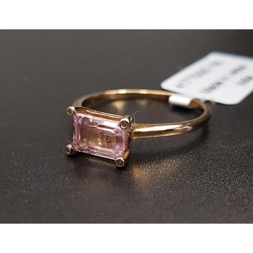 38 - CERTIFIED KUNZITE AND DIAMOND RING the central octagon cut Mawi kunzite weighing 1.23cts, with a sma...
