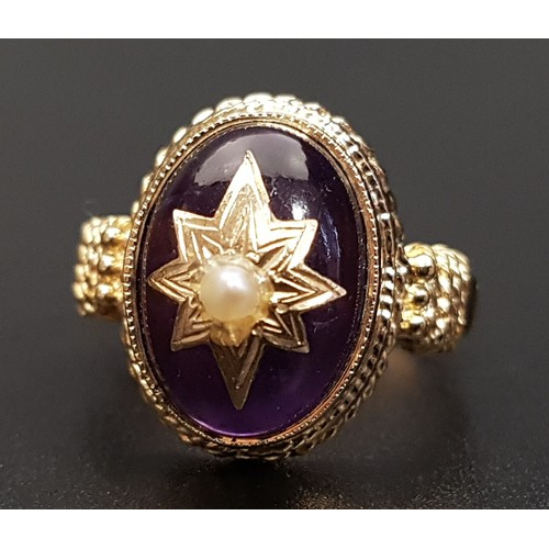 40 - VICTORIAN STYLE AMETHYST RING the oval cabochon amethyst with central gold star decoration set with ...