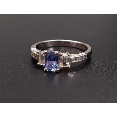42 - IMPRESSIVE TANZANITE AND DIAMOND RING the central radiant cut tanzanite approximately 0.45cts, flank...
