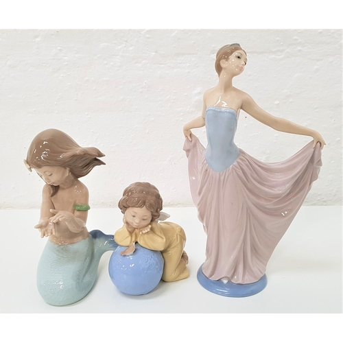 53 - THREE LLADRO AND NAO FIGURINES comprising a Lladro figure of an elegant lady in an evening dress, th...
