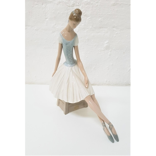54 - LARGE NAO FIGURINE of a seated ballerina, 33m high