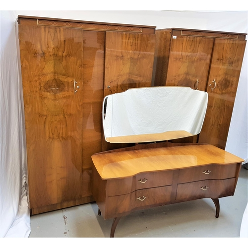 115 - BEAUTILITY WALNUT BEDROOM SUITE comprising a shaped mirror back dressing table with a breakfront bas...