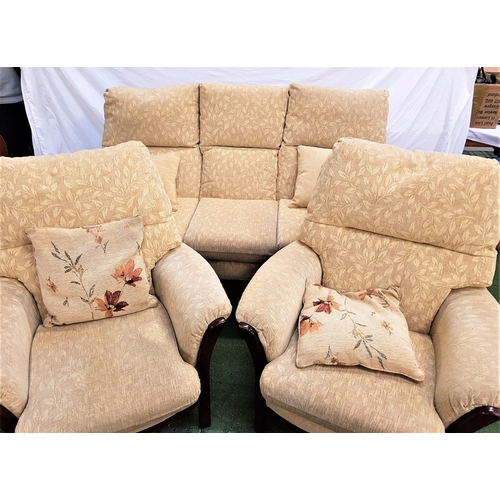 120 - THREE PIECE SUITE with a dark stained frame, comprising a three seat sofa and two armchairs, all wit...