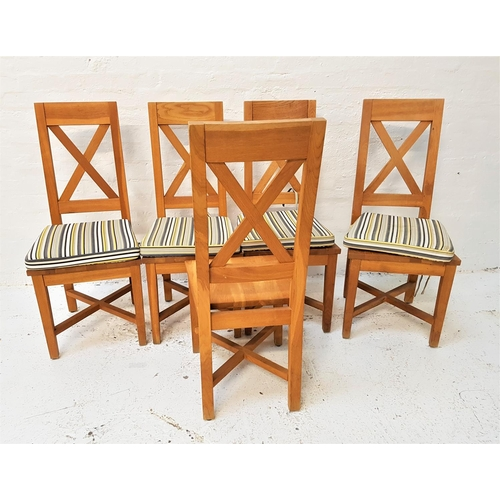 122 - SET OF FIVE LIGHT OAK DINING CHAIRS with X frame backs above solid seats, standing on tapering suppo...