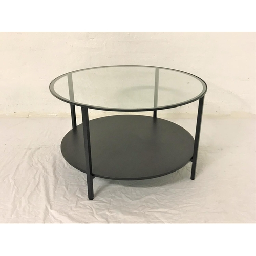 125 - CIRCULAR METAL OCCASIONAL TABLE with inset glass top, standing on plain supports united by an undert...