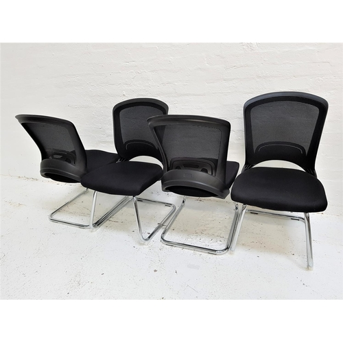 126 - SET OF FOUR OFFICE CHAIRS with shaped mesh fabric backs above black fabric padded seats, on a tubula...