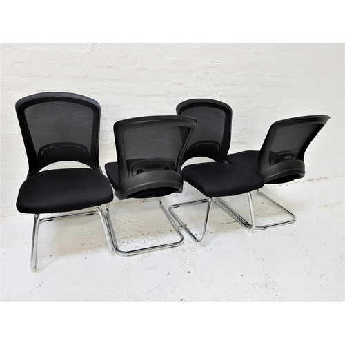 127 - SET OF FOUR OFFICE CHAIRS with shaped mesh fabric backs above black fabric padded seats, standing on...