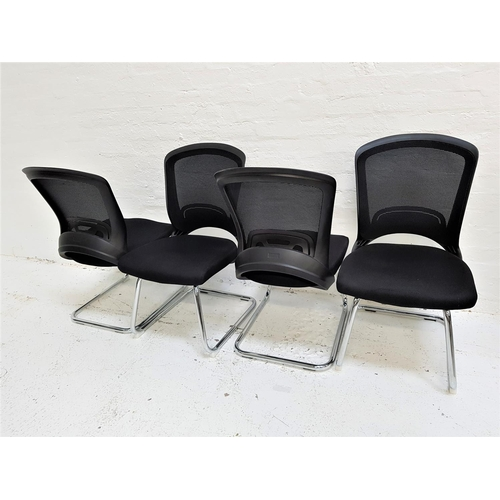 128 - SET OF FOUR OFFICE CHAIRS with shaped mesh fabric backs above black fabric padded seats, standing on...