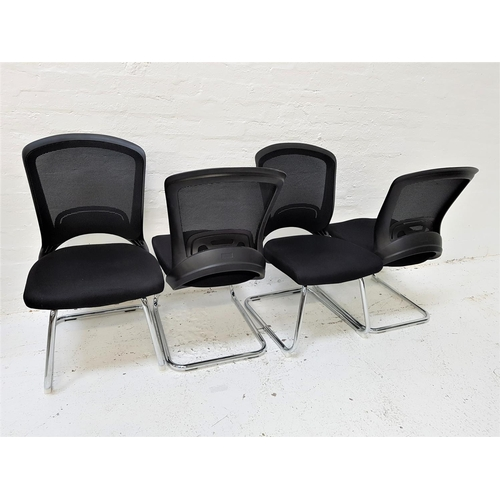 129 - SET OF FOUR OFFICE CHAIRS with shaped mesh fabric backs above black fabric padded seats, standing on...