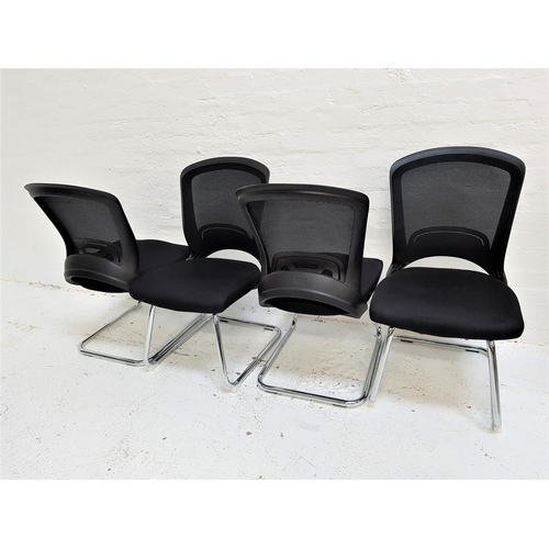 130 - SET OF FOUR OFFICE CHAIRS with shaped mesh fabric backs above black fabric padded seats, standing on...