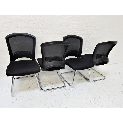 133 - SET OF FOUR OFFICE CHAIRS with shaped mesh fabric backs above black fabric padded seats, standing on...