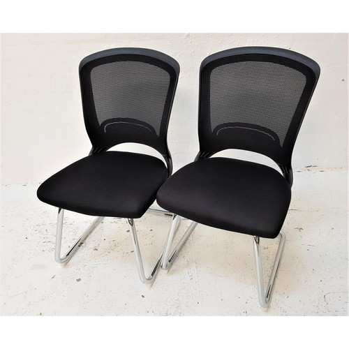 134 - PAIR OF OFFICE CHAIRS with shaped mesh fabric backs above black fabric padded seats, standing on a t...