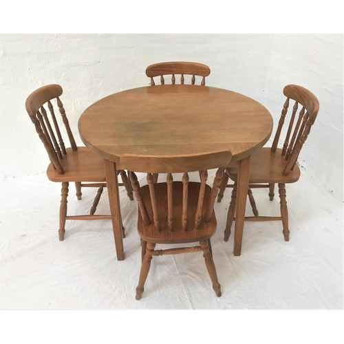 140 - CIRCULAR LIGHT OAK KITCHEN TABLE with a broad frieze, standing on tapering supports, 105cm diameter,...