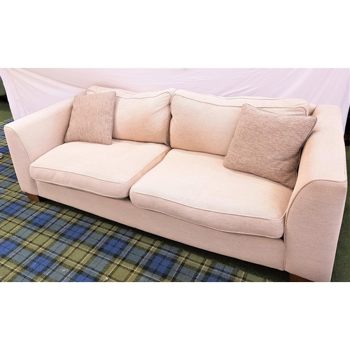 141 - PAIR OF LARGE THREE SEAT SOFAS in textured cream fabric with two mushroom coloured scatter cushions ...