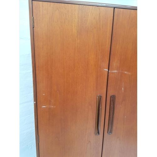 143 - RETRO G PLAN FRESCO TEAK WARDROBE  having twin doors with lipped and recessed handles, the interior ...