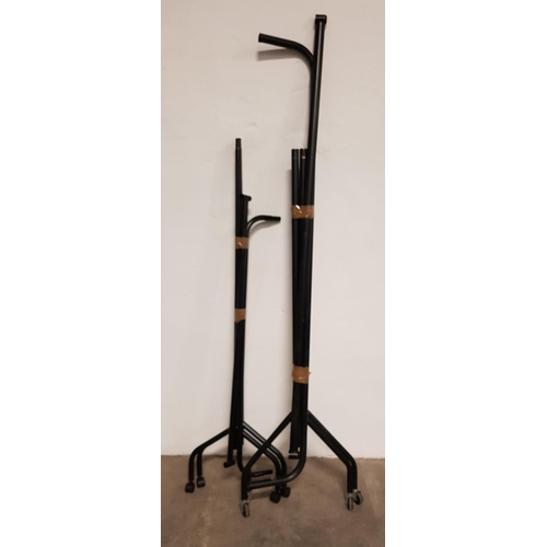 15 - TWO CLOTHES RAILS Both in black and with wheels, the rails measuring 183cm and 120cm long respective...