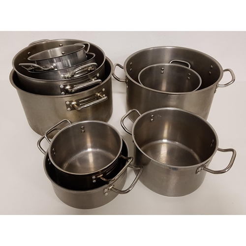 40 - SELECTION OF NINE GRADUATED COOKING POTS...