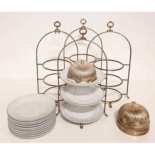 45 - FOUR STAINLESS STEEL THREE TIER CAKE STANDS with plates and cloche for top tier...