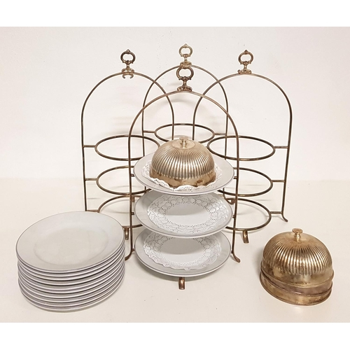 46 - FOUR STAINLESS STEEL THREE TIER CAKE STANDS with plates and cloche for top tier