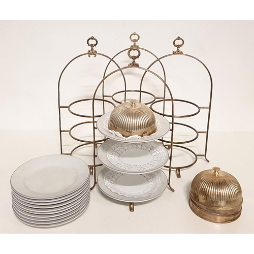 47 - FOUR STAINLESS STEEL THREE TIER CAKE STANDS with plates and cloche for top tier...