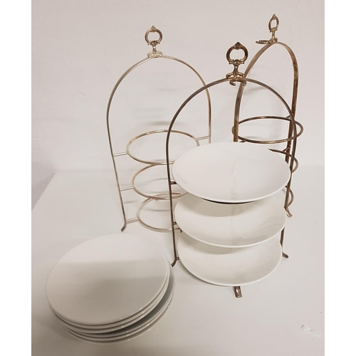 48 - THREE STAINLESS STEEL THREE TIER CAKE STANDS with plates...