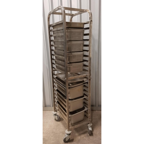 73 - WHEELED GASTRONORM RACKING TROLLEY with twenty shelving slots, with four 1/1 steamer trays and four ...
