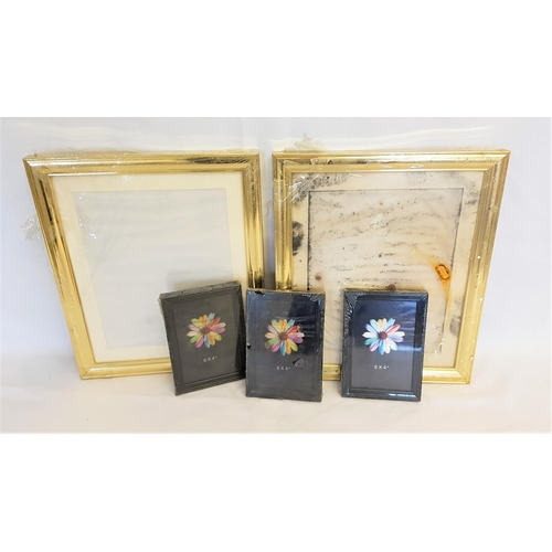 201 - FIVE PHOTO FRAMES  three 15x10 black and two 24x30 gold effect...
