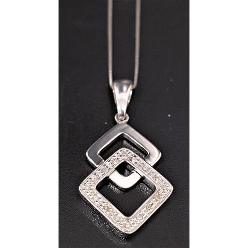 4 - DIAMOND SET PENDANT the diamonds set to the lower of two interlocking geometric links, in nine carat...