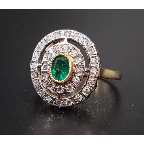 22 - ATTRACTIVE ART DECO STYLE EMERALD AND DIAMOND PLAQUE RING the central oval cut emerald in double dia...