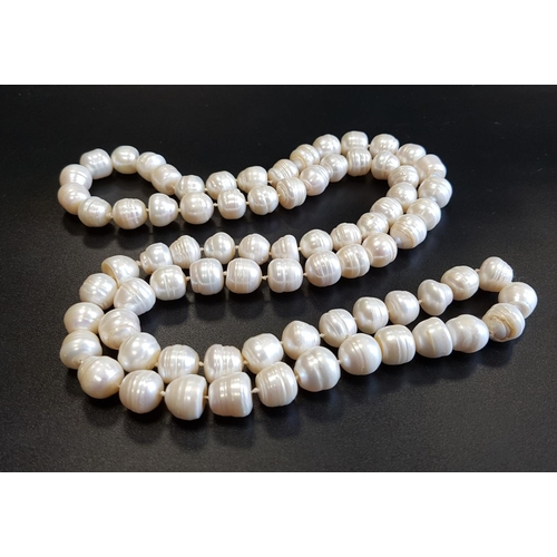 43 - LONG FRESHWATER BAROQUE PEARL NECKLACE with individually knotted pearls, approximately 92cm long...