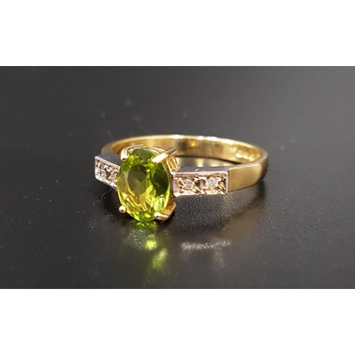 55 - PERIDOT AND DIAMOND RING the central oval cut peridot approximately 1.1cts, flanked by two diamonds ...