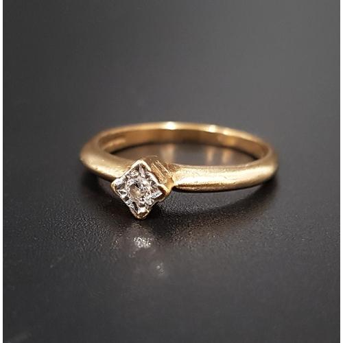 57 - DIAMOND SOLITAIRE RING  the illusion set diamond approximately 0.05cts, on nine carat gold shank, ri...
