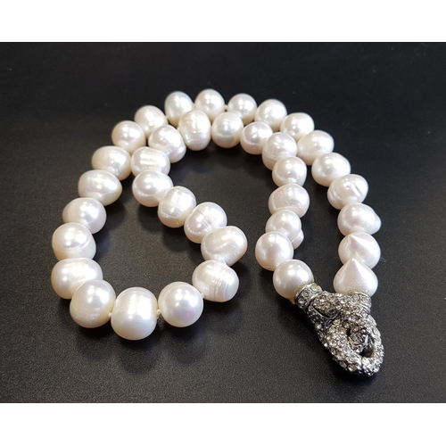 64 - FRESHWATER PEARL NECKLACE with unusual rhinestone set clasp, 46cm long...