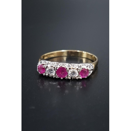 67 - GRADUATED RUBY AND DIAMOND FIVE STONE RING the rubies totaling approximately 0.35cts and diamonds ap...