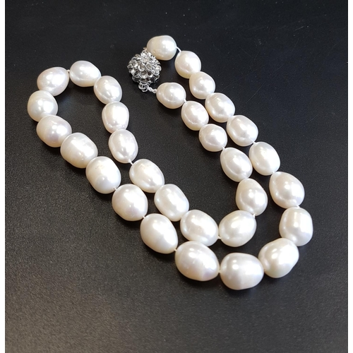 87 - FRESHWATER PEARL NECKLACE all individually knotted and with flower design clasp, approximately 44cm ...